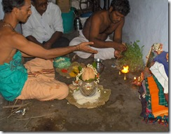 Mother's puja - offering camphor to picture of mother