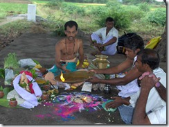 Offering camphor to altar