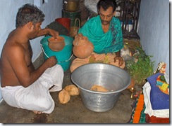 Preparing items for puja at village temple