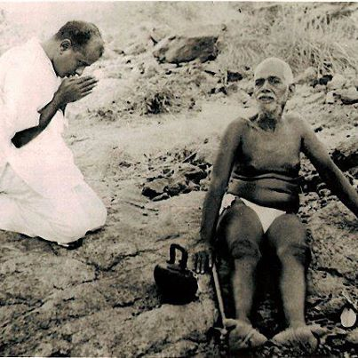 bhagavan-sitting-and-a-person-offering-his-respect